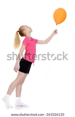 beautiful caucasian girl holding at arm's length balloons, standing sideways to the camera - isolated on white. - stock photo