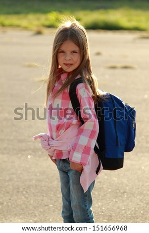 Beautiful caucasian girl with happy expression goes to school  - stock photo