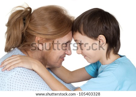 Beautiful Caucasian grandmother with her grandson on a white background