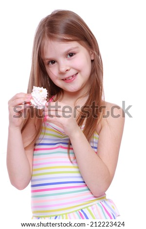Beautiful caucasian little girl wearing pink swimsuit holding sea shell isolated over white background