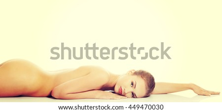 Beautiful caucasian naked woman lying down. - stock photo