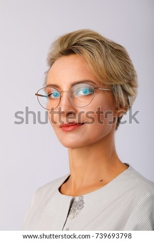 Beautiful caucasian short haired business woman close up portrait.