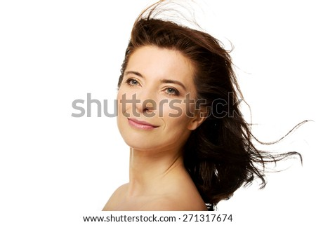 Beautiful caucasian spa woman with wind in hair. - stock photo