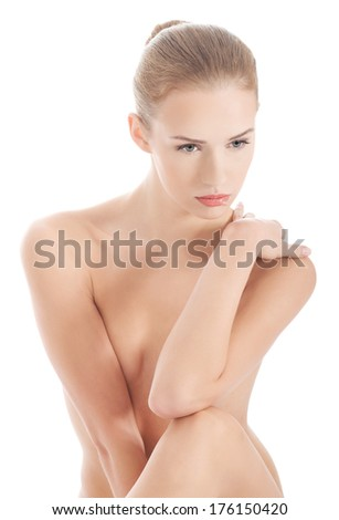 Beautiful caucasian topless woman. Isolated on white.