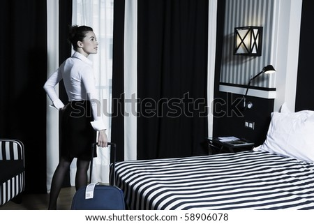 beautiful caucasian woman discovering the hotel bedroom - stock photo