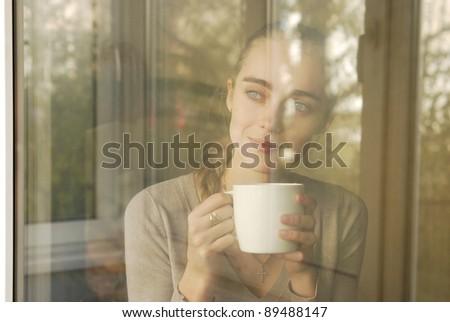 beautiful caucasian woman drinking coffee - stock photo