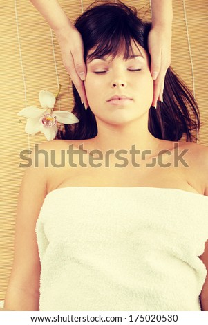 Beautiful caucasian woman getting spa treatment, isolated  - stock photo