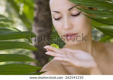 Beautiful caucasian woman holding natural aloe vera facial gel, skin care and wellness. Facial moisturize mask, spa salon outdoors. - stock photo