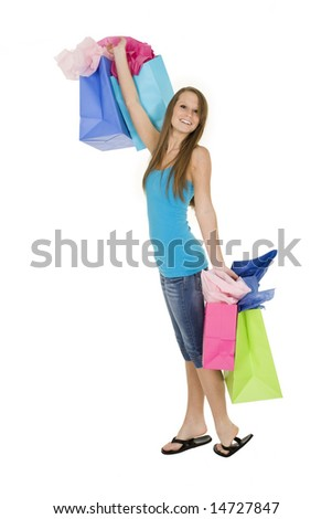 Beautiful Caucasian woman holding shopping bags while standing on a white background