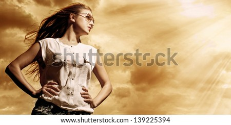 Beautiful caucasian woman in casual over sky background - stock photo