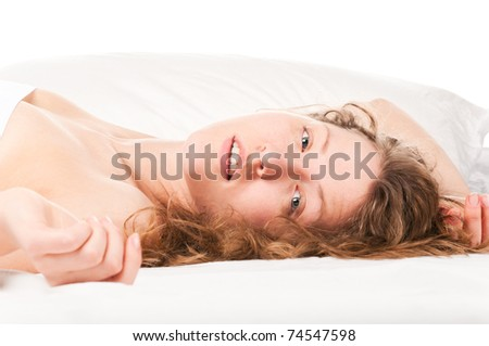 beautiful caucasian woman is lying in bed at  morning