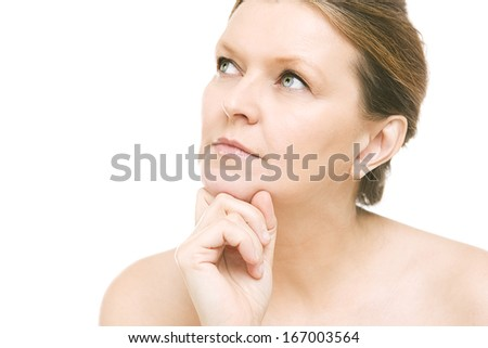 beautiful caucasian woman looking thoughtfully, mid adult female face - Portrait of serene aged woman over white background - stock photo