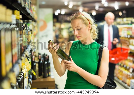 Beautiful caucasian woman shopping groceries at supermarket. - stock photo