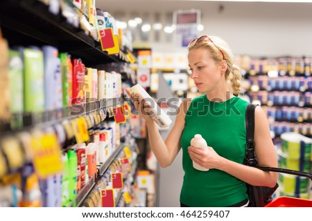 Beautiful caucasian woman shopping personal hygiene products at supermarket.