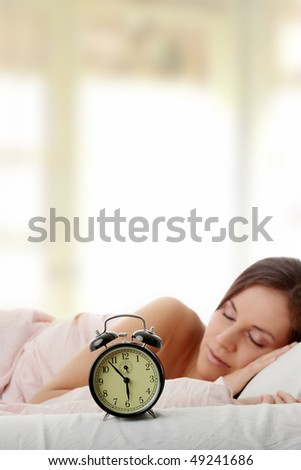 Beautiful Caucasian woman waking up in the morning.