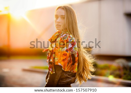 Beautiful caucasian woman walking on the road in autumn - stock photo
