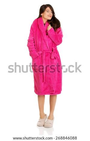 Beautiful caucasian woman wearing pink bathrobe. - stock photo