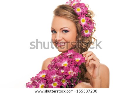 Beautiful caucasian woman with flowers in her hair and hands isolated over white background