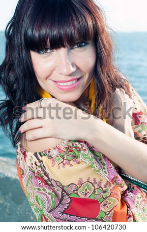 Beautiful caucasian woman with luxury hair outdoors, close-up