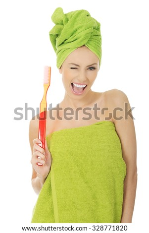 Beautiful caucasian woman with oversized toothbrush. - stock photo