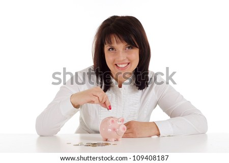 Beautiful Caucasian woman with piggy bank sitting on a light background
