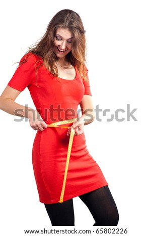 Beautiful caucasian women hold a tape measure and happy. Isolated on white background. - stock photo