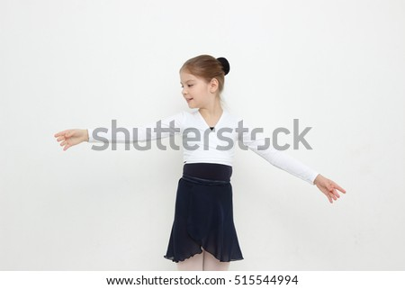 Beautiful caucasian young ballerina is posing on camera