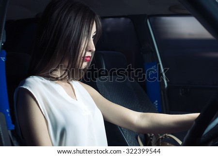 beautiful caucasian young girl poses near retro car warm autumn evening on the road. shows his emotions, smile, nice clothes and makeup