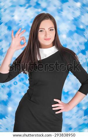 beautiful caucasian young woman showing OK gesture - stock photo