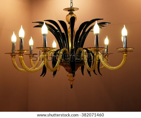 Beautiful chandelier on the ceiling - stock photo