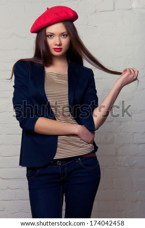 Beautiful charming girl in red beret. French Style - stock photo