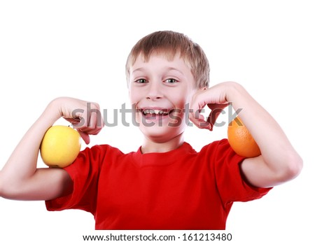 Beautiful cheerful boy in red t-shirt poses with two pieces of an orange smiling  (isolated on white background) - stock photo