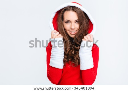 Beautiful cheerful curly young woman in red santa claus costume with hood isolated over white background - stock photo