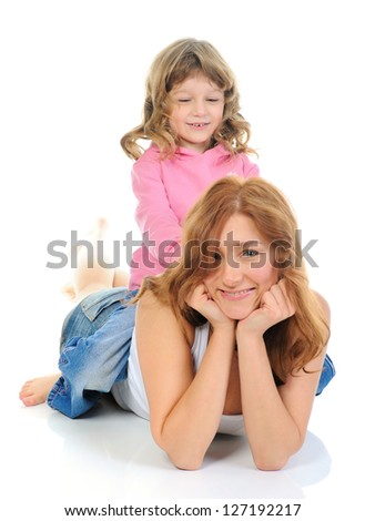 beautiful cheerful girl hugs her young mother. Isolated on white background