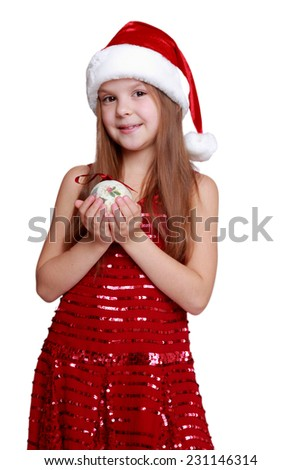 Beautiful cheerful little girl in a dress holding a shiny Christmas balls on white background/Smiley little santa girl holding Christmas and New Year decoration - stock photo