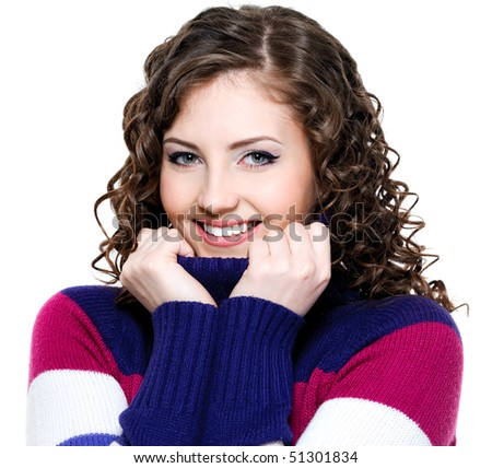 Beautiful cheerful smiling woman with colored warm sweater - stock photo