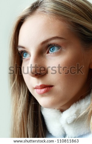 beautiful cheerful teenage girl face with natural make up blue eyes and perfect skin close up