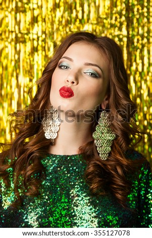 beautiful cheerful woman in christmas party on sparkling background. - stock photo