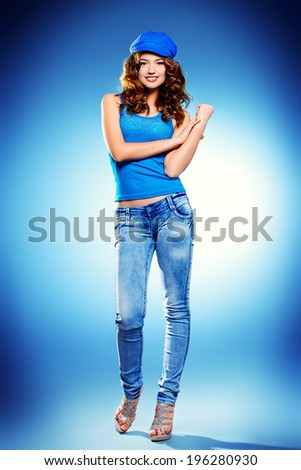 Beautiful cheerful woman smiling at the camera. Full length portrait. - stock photo