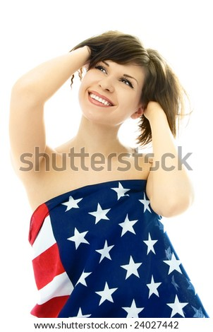 beautiful cheerful young nude woman wrapped into an American flag, isolated against white background