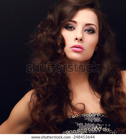 Beautiful chic female model with bright makeup looking sexy on black. Closeup portrait - stock photo