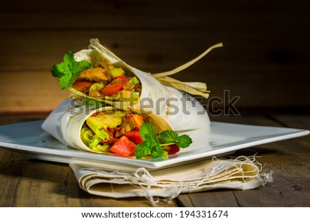 Beautiful chicken and vegetable bread tied with banana leaf - stock photo