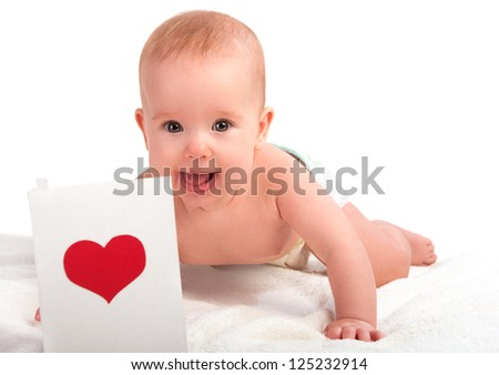 beautiful child, baby and postcard  Valentine's Day with a red heart - stock photo