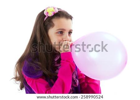 Beautiful child blowing a balloon - stock photo