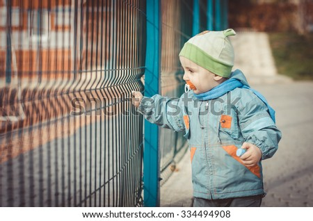 beautiful child dressed in a blue jacket - stock photo