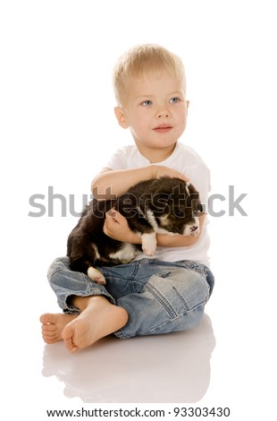 Beautiful child embracing a cute dog. isolated on white background