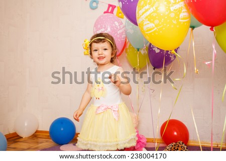 beautiful child enjoying life. Portrait of a beautiful  little girl close-up - stock photo