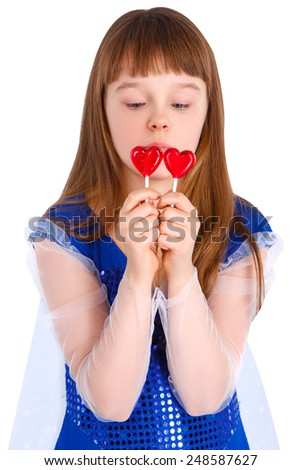 Beautiful child girl  holding a lollipop in the shape of a red heart valentines day