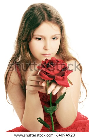 Beautiful child girl with red rose. Romantic dreamy child 10 years old with flower isolated on white