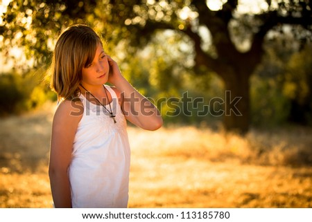beautiful child in afternoon light - stock photo